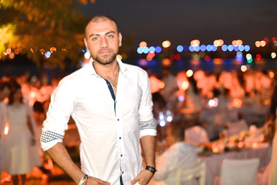 Roy Abdo, The global phenomenon secret dinner party, Diner en Blanc, attracted over 1,300 guests all wearing white.  The Yards Park, Thursday, September 4, 2014.  Photo by Ben Droz